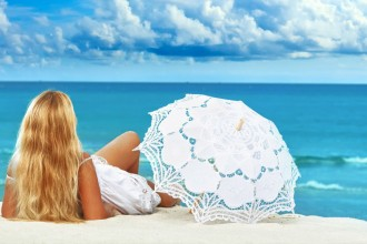 Woman-with-Umbrella-on-beach