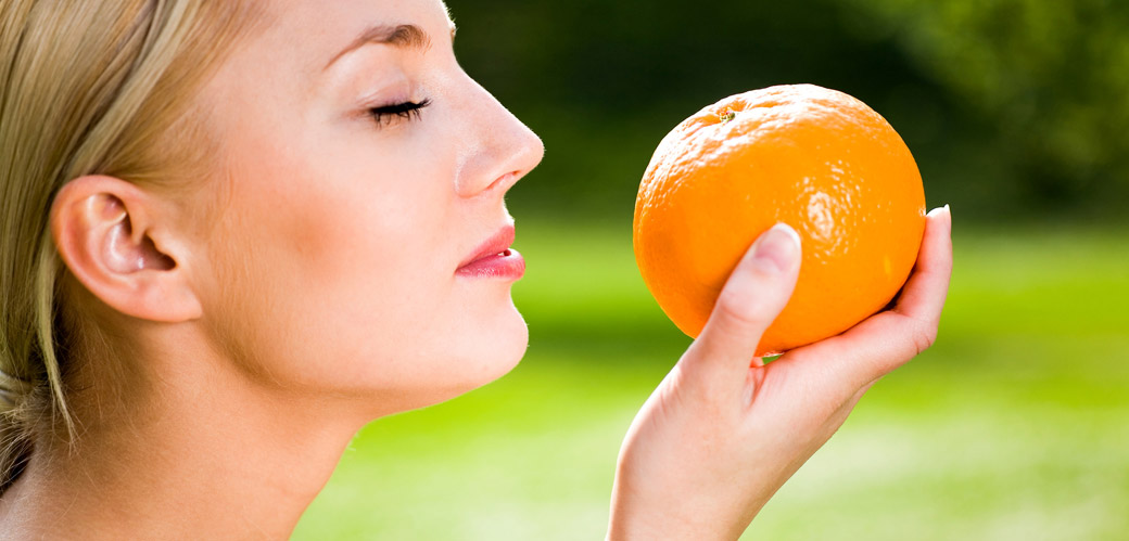 Woman-smelling-orange