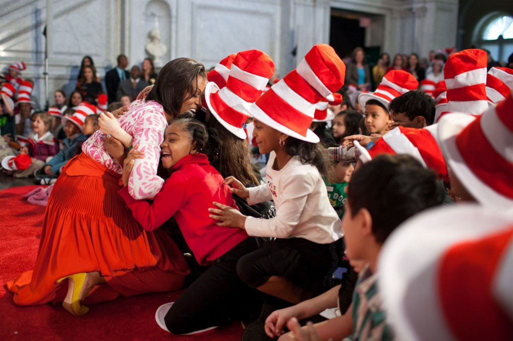 Michelle obama hug cat in the hat