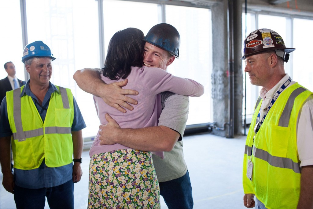 Michelle obama hug construction worker