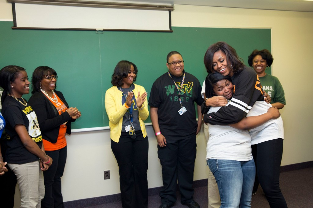 Michelle obama hug crying in schools