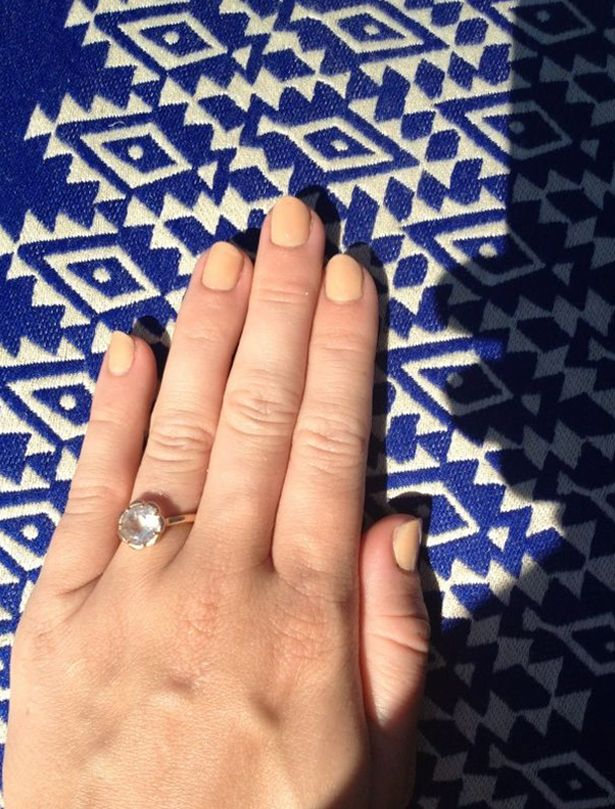Miley Cyrus posts a picture on Twitter of her engagement ring