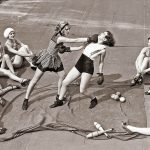 women-boxing-on-a-roof-vintage