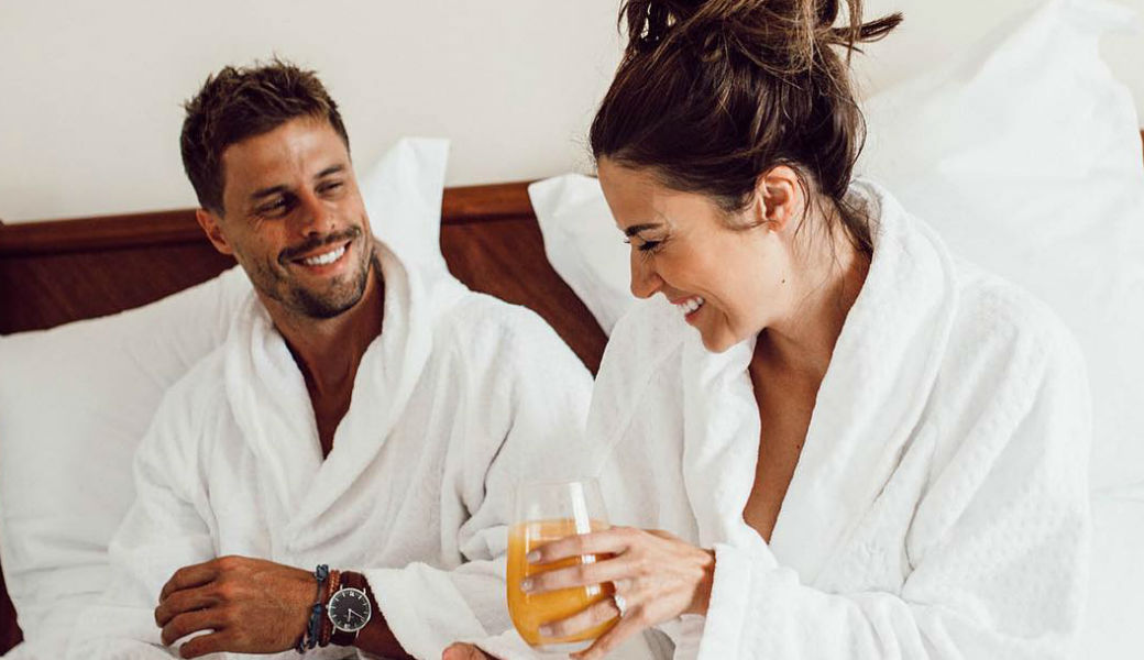 couple-in-bed-eating-breakfast-robes-m2woman