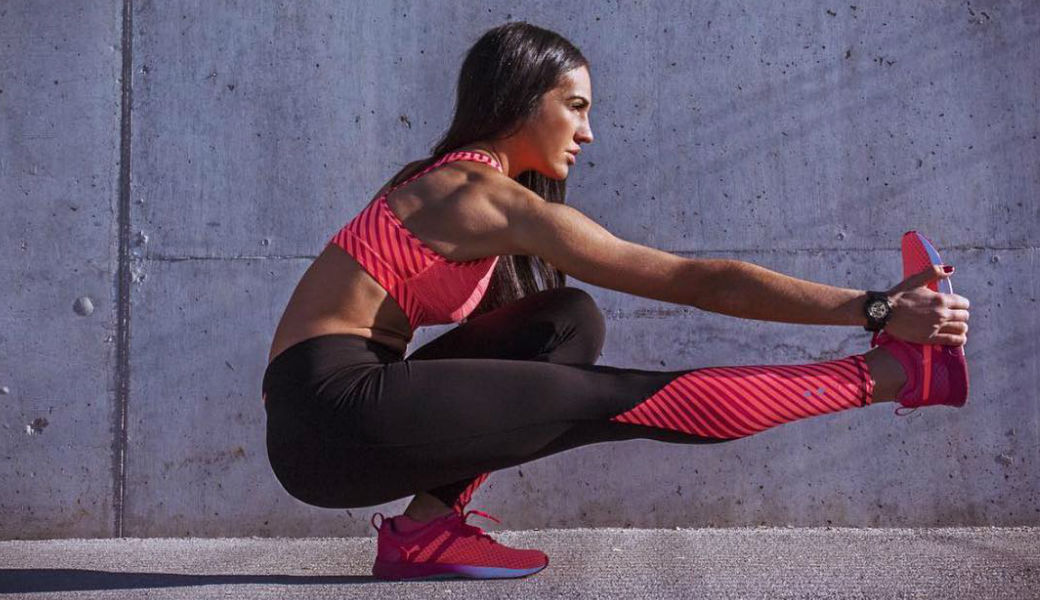 hot-brunette-stretching-exercise-puma-m2woman